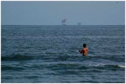 Author Scott Cassel goes for a dip in the Gulf of Mexico
